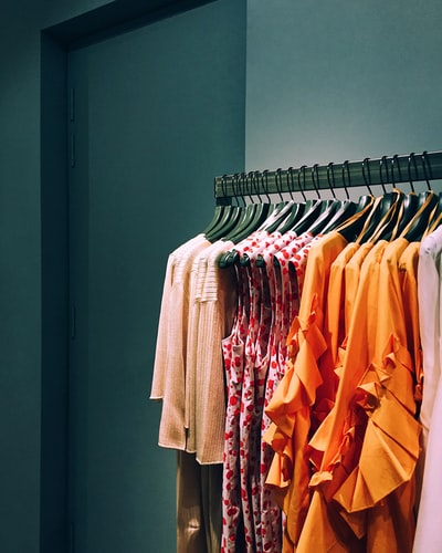 Why does the grocery industry not want women to buy clothing with a gender-neutral label?